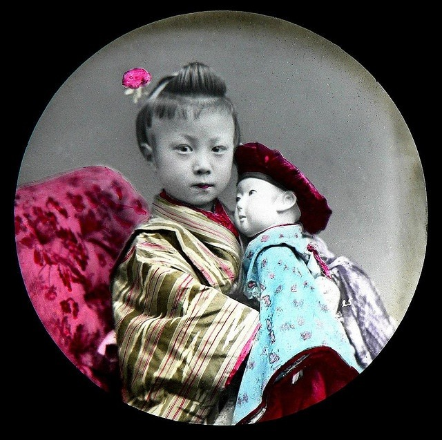 Young Japanese girl and her doll. Late 1870s to 1880s