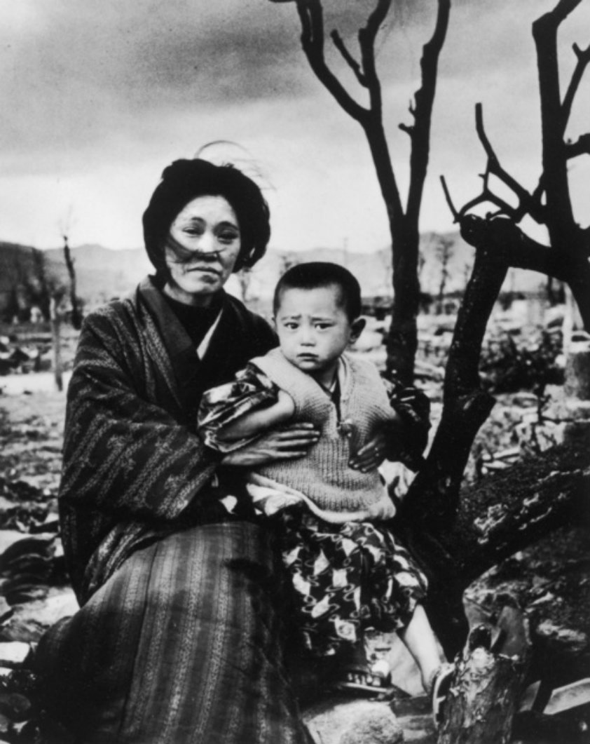 Japanese mother holding her child amongst the ruins of Hiroshima.
