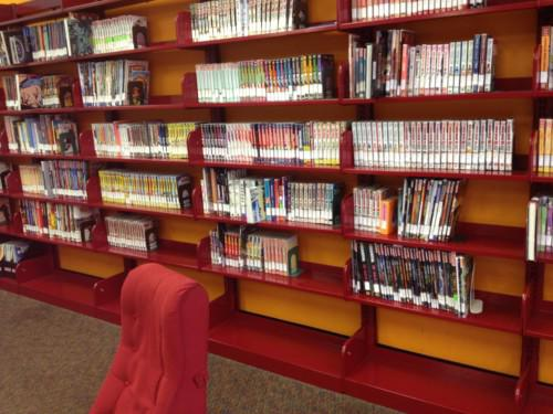 A manga collection at a public library. Notice the space on the shelves that allows for expansion.