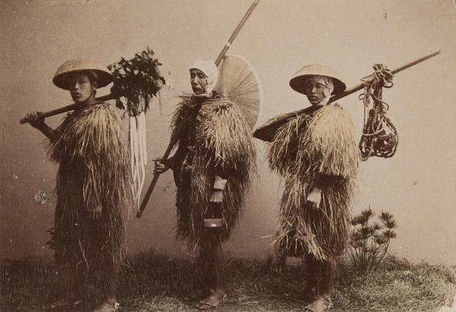 Japanese farmers wearing rain coats