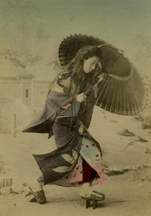 Photograph of a Japanese woman braced against the wind.